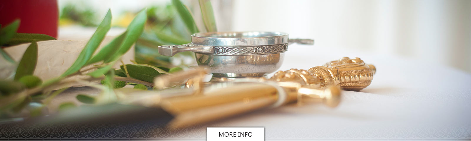 Celtic silver napkin ring and gold sword on a table