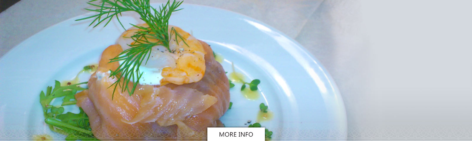 Cheese wrapped in Scottish salmon with dill garnish
